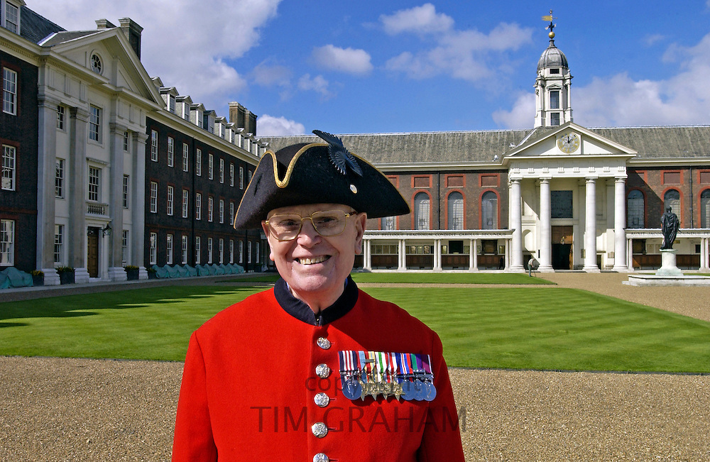 A Chelsea pensioner standing outside the Royal Hospital Chelsea, London