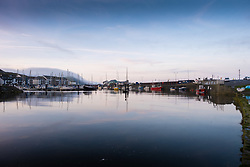 ©Licensed to London News Pictures.<br /> Aberystwyth UK  20/03/2019<br /> A misty and calm Vernal or Spring Equinox morning in Aberystwyth, as the day breaks over the boats moored in the harbour. Today is the first day of astronomical spring, where the night and day are of equal length. <br /> Photo credit: Keith Morris/LNP