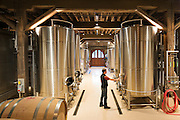 Wine maker Cameron Parry in the newly renovated wine cellar at historic Chateau Montelena winery in Napa Valley, Calistoga, California