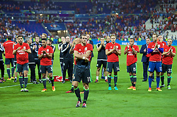 LYON, FRANCE - Wednesday, July 6, 2016: Wales' Gareth Bale and his team wear shirt with 'Diolch' on [Thank-you in Welsh] as they salute their supporters after the 2-0 defeat to Portugal during the UEFA Euro 2016 Championship Semi-Final match at the Stade de Lyon. (Pic by David Rawcliffe/Propaganda)