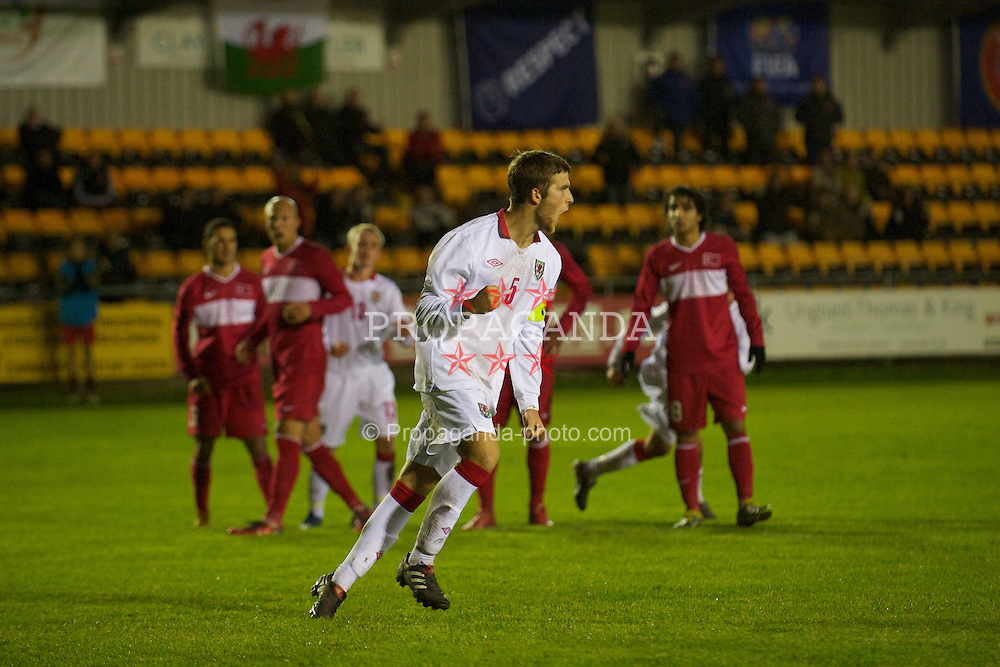 CARMARTHEN, WALES - Wednesday, October 20, 2010: Wales' Adam Matthews celebrates scoring from the penalty spot with virtually the last kick of the match to make it 3-3 against Turkey during the UEFA Under-19 Championship Qualifying Group 1 match at Richmond Park. (Photo by Gareth Davies/Propaganda)