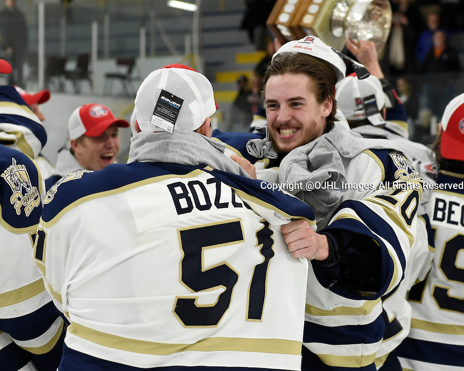TORONTO, ON - Apr 22, 2015 : Ontario Junior Hockey League game action between the Toronto Patriots and the Kingston Voyaguers. Game seven of the Buckland Cup Championship Series. Mathew Robson #20 celebrates winning the Buckland Cup  with his teammate Marco Bozzo #51 of the Toronto Patriots.<br /> (Photo by Andy Corneau / OJHL Images)