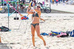 © Licensed to London News Pictures. 12/07/2020. Brighton, UK. Members of the Brighton Beach volleyball team play a game on the beach in Brighton and Hove as sunny and warm weather is hitting the seaside resort. Photo credit: Hugo Michiels/LNP