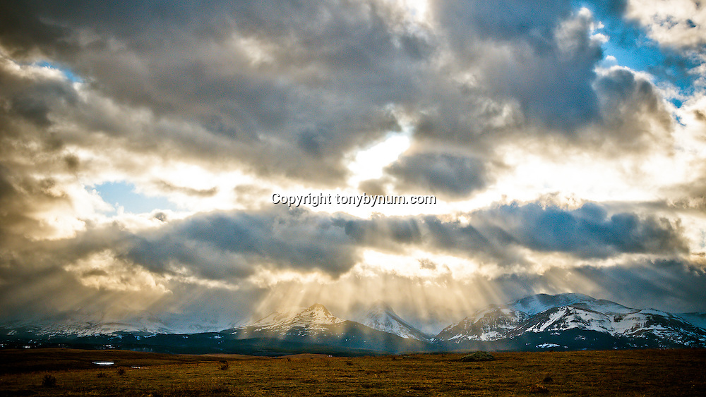 sun breaks though the clouds south end of glacier national park