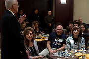 "UConn President Susan Herbst looks on while former head coach Donald ""Dee"" Rowe speaks during a supporters brunch at the Hyatt Regency in Dallas, Texas before watching her school compete in the NCAA Final Four on April 5, 2014. (Cooper Neill / for The New York Times)"