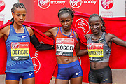 Roza Dereje (Ethiopia) third Place, Brigid Kosgei (Kenya) first place, Vivian Cheruiyot (Kenya) second place, Women's Elite race, during the Virgin Money 2019 London Marathon, London, United Kingdom on 28 April 2019.