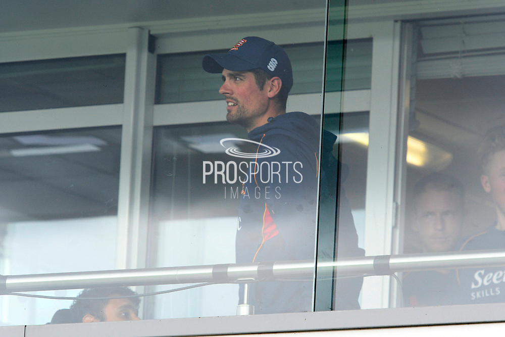 Alastair Cook of Essex looks through the dressing room balcony window as the delay to the start of play due to rain continues during the Specsavers County Champ Div 1 match between Somerset County Cricket Club and Essex County Cricket Club at the Cooper Associates County Ground, Taunton, United Kingdom on 25 September 2019.