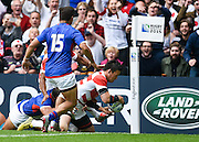 Japan full back Ayumu Goromaru going over the try line before it was ruled out by the TMO during the Rugby World Cup Pool B match between Samoa and Japan at stadium:mk, Milton Keynes, England on 3 October 2015. Photo by David Charbit.