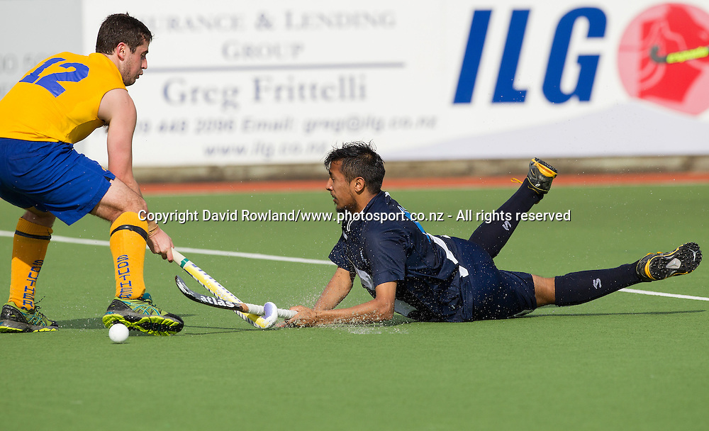 Auckland`s Jignesh Keshoor dives at Southern`s Nick Elder in the Auckland v Southern Men`s semi-final match, Ford National Hockey League, North Harbour Hockey Stadium, Auckland, New Zealand,Saturday, September 13, 2014. Photo: David Rowland/Photosport