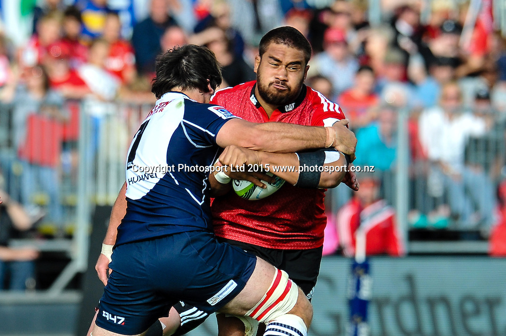 Nepo Laulala of the Crusaders is tackled by Warwick Tecklenburg of the Lions during the Super Rugby match: Crusaders v Lions at AMI Stadium, Christchurch, New Zealand, 14 March 2015. Copyright Photo: John Davidson / www.Photosport.co.nz