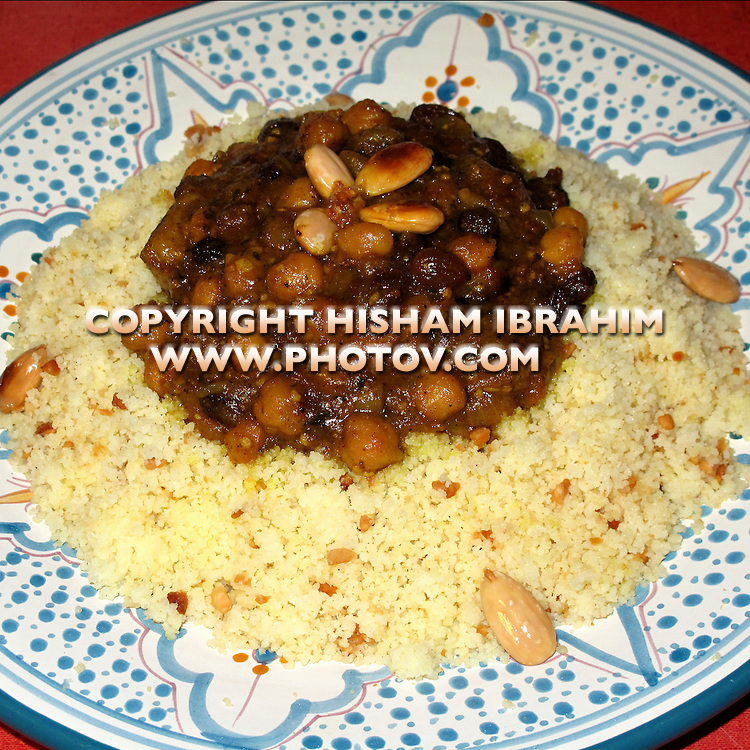 Couscous - Couscous Tfaya - Couscous with carmelized onions, raisins and chickpeas - Traditional Moroccan Dish.
