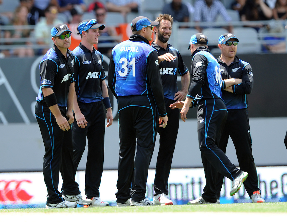 New Zealand's Grant Elliott, centre, after deflecting the ball to run out Pakistan's Mohammad Rizwan for 16 in the 3rd ODI International Cricket match at Eden Park, Auckland, New Zealand, Sunday, January 31, 2016. Credit:SNPA / Ross Setford