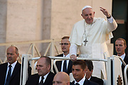 VATICAN CITY 04 OCTOBER 2017: Pope Francis arrives at the General Audience with Pope Francis in his PopeMobile on October 04, 2017 at Saint Peters Square in Vatican City, Rome, Italy.