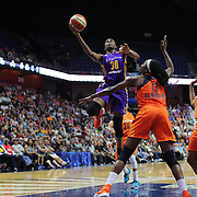 UNCASVILLE, CONNECTICUT- JULY 15:  Nneka Ogwumike #30 of the Los Angeles Sparks drives to the basket defended by her sister Chiney Ogwumike #13 of the Connecticut Sun during the Los Angeles Sparks Vs Connecticut Sun, WNBA regular season game at Mohegan Sun Arena on July 15, 2016 in Uncasville, Connecticut. (Photo by Tim Clayton/Corbis via Getty Images)