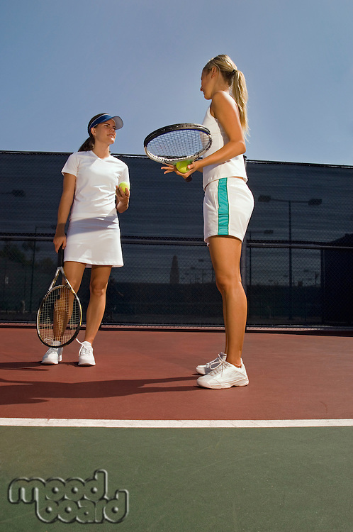 Tennis Doubles Partners Discussing Strategy