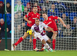 CARDIFF, WALES - Tuesday, February 11, 2014: Aston Villa's Gabriel Agbonlahor in action against Cardiff City's Magnus Wolff Eikrem during the Premiership match at the Cardiff City Stadium. (Pic by David Rawcliffe/Propaganda)