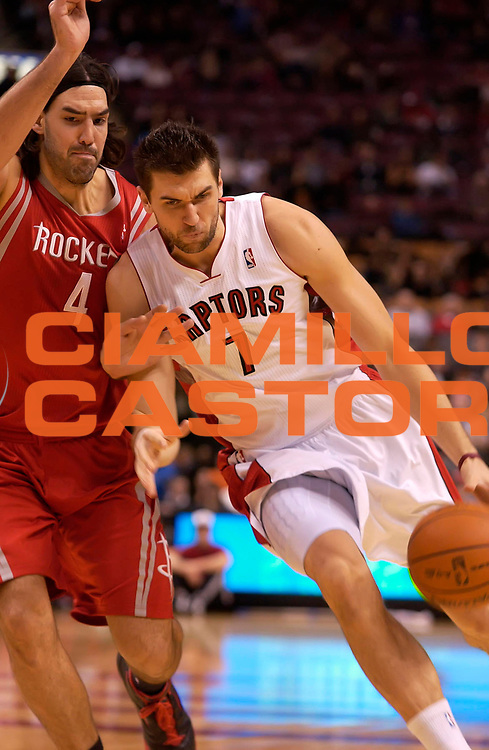 DESCRIZIONE : Toronto NBA 2010-2011 Toronto Raptors Houston Rockets<br /> GIOCATORE : Andrea Bargnani<br /> SQUADRA : Toronto Raptors Houston Rockets<br /> EVENTO : Campionato NBA 2010-2011<br /> GARA : Toronto Raptors Houston Rockets<br /> DATA : 19/11/2010<br /> CATEGORIA :<br /> SPORT : Pallacanestro <br /> AUTORE : Agenzia Ciamillo-Castoria/V.Keslassy<br /> Galleria : NBA 2010-2011<br /> Fotonotizia : Toronto NBA 2010-2011 Toronto Raptors Houston Rockets<br /> Predefinita :