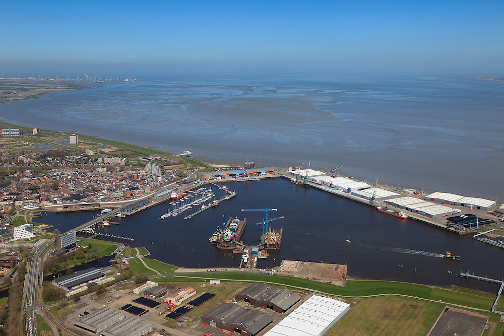 Nederland, Groningen, Delfzijl, 01-05-2013; haven Delfzijl met droogdokken en jachthaven Neptunus. In de achtergrond de Eems.<br /> Delfzijl harbor with docks and marina Neptune. In the background the Ems.<br /> luchtfoto (toeslag op standard tarieven);<br /> aerial photo (additional fee required);<br /> copyright foto/photo Siebe Swart