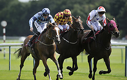 Treasury Notes and Danny Tudhope(left) get up close to the finish to win the Betfred Duke of Lancasters Own Yeomanry Stakes during Betfred Rose Of Lancaster Stakes Ladies Day at Haydock Park Racecourse.