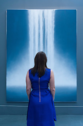 "© Licensed to London News Pictures. 19/05/2016. London, UK. A visitor looks at Hiroshi Senju's ""Waterfall"".  Art16 opens at Olympia, in west London.  Now in its fourth edition, the fair brings together over 100 galleries from more than 30 countries showcasing a diverse cross-section of work by contemporary artists from around the world for buyers and art enthusiasts to visit. Photo credit : Stephen Chung/LNP"