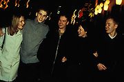 After Clubs, three men and two women dressed in plain clothes, Coral Street, Manchester, 2000's.