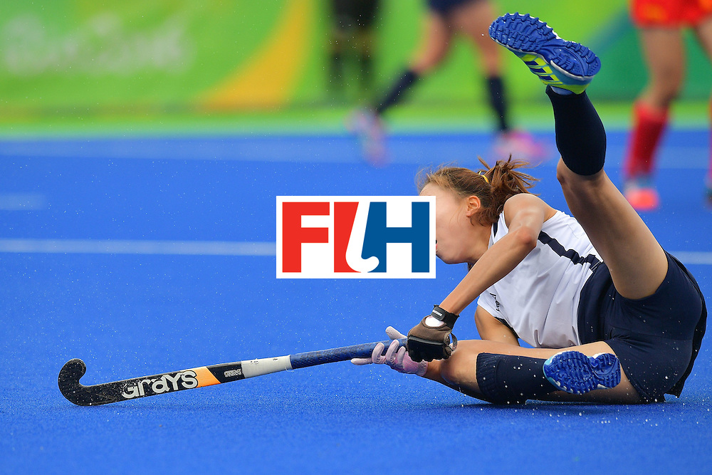 South Korea's Kim Hyunji falls during the womens's field hockey South Korea vs China match of the Rio 2016 Olympics Games at the Olympic Hockey Centre in Rio de Janeiro on August, 12 2016. / AFP / Carl DE SOUZA        (Photo credit should read CARL DE SOUZA/AFP/Getty Images)