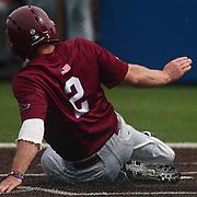 Saint Joseph's Infielder Taylor Boyd (2) slides into home plate during a regular season baseball game between Delaware and Saint Joseph's at Bob Hannah Stadium Tuesday April 19, 2016, in Newark.