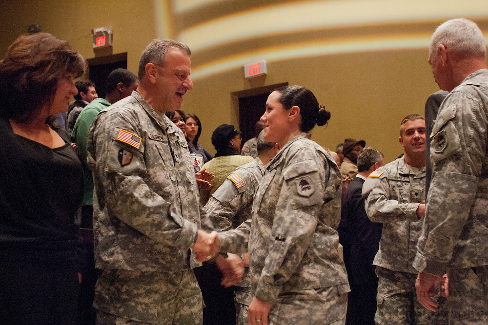 Gloucester Township police Lieutenant and Staff Sargent in the 119th Combat Sustainment Support Battalion, Lisa Hatcher shakes a superior's hand as she is introduced during a ceremony for her battalion at Rowan University's Pfleeger Hall in Glassboro, NJ on Saturday December 18, 2010. (photo / Mat Boyle).