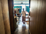 02 JUNE 2015 - KULAI, JOHORE, MALAYSIA: FOZOL AHMAD BIN HABI, a Rohingya refugee from Sittwe, Myanmar, walks back to his room in Kulai, Malaysia. He was an Imam in Myanmar but now is not healthy enough to work or preach and relies on the kindness of his neighbors to meet his needs. He lives in a small room in a tenement he shares with seven other Rohingya families. The UN says the Rohingya, a Muslim minority in western Myanmar, are the most persecuted ethnic minority in the world. The government of Myanmar insists the Rohingya are illegal immigrants from Bangladesh and has refused to grant them citizenship. Most of the Rohingya in Myanmar have been confined to Internal Displaced Persons camp in Rakhine state, bordering Bangladesh. Thousands of Rohingya have fled Myanmar and settled in Malaysia. Most fled on small fishing trawlers. There are about 1,500 Rohingya in the town of Kulai, in the Malaysian state of Johore. Only about 500 of them have been granted official refugee status by the UN High Commissioner for Refugees. The rest live under the radar, relying on gifts from their community and taking menial jobs to make ends meet. They face harassment from Malaysian police who, the Rohingya say, extort bribes from them.     PHOTO BY JACK KURTZ