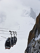 If weather is good on top of Aiguille du Midi, board the Vallee Blanche Aerial Tramway (also called Funivia dei Ghiacciai, or Télécabine Panoramic Mont-Blanc) to Pointe Helbronner, France, Europe. Don't miss the Téléphérique de l'Aiguille du Midi cable car from Chamonix (France) to a spectacular shoulder of the Mont Blanc Massif. Take the world's highest vertical ascent cable car, from 1035 meters to 3842 m (12,605 feet).