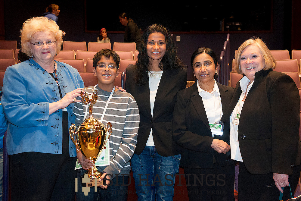 1 MARCH 2014 -- LEBANON, Ill. -- 2014 St. Louis Post-Dispatch Spelling Bee winner Gokul Venkatachalam (second from left), of Parkway West Middle School, a three-time champion, poses for a photograph with Dr. Lekshmi Nair (third from left), a Parkway West alum who won the  championship in 1988, 1989 and 1990. Joining them in the photograph are judges Helen Rager (left), Indira Nair (fourth from left) and Jan Shayne. The 2014 championship was held at McKendree University in Lebanon Saturday, March 1, 2014. Photo © copyright 2014 Sid Hastings.
