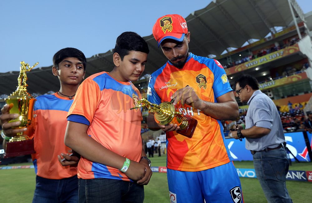Ravindra Jadeja of the Gujarat Lions gives an award to  Shrey Mehta winner of Topps Cricket Attax during match 35 of the Vivo 2017 Indian Premier League between the Gujarat Lions and the Mumbai Indians  held at the Saurashtra Cricket Association Stadium in Rajkot, India on the 29th April 2017<br /> <br /> Photo by Sandeep Shetty - Sportzpics - IPL