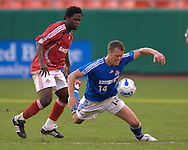 July 1, 2007 - Kansas City, MO..Kansas City Wizards defender Jack Jewsbury #14  gets fouled from behind going for the ball by Toronto FC midfielder Collin Samuel (L) in the first half at Arrowhead Stadium in Kansas City, Missouri on July 1, 2007...MLS:  The Toronto FC and Wizards ended in a 1-1 tie.   .Photo by Peter G. Aiken / Cal Sport Media