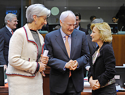 Christine Lagarde, France's finance minister, left, and Philippe Maystadt, president of the European Investment Bank, center, speak with Elena Salgado, Spain's finance minister, during the meeting of European finance ministers, at EU Council headquarters in Brussels, Belgium, on Tuesday, Feb. 16, 2010. (Photo © Jock Fistick)