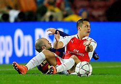 Arsenal's Alexis Sanchez reacts after fouling Andres Iniesta of Barcelona  - Mandatory byline: Matt McNulty/JMP - 16/03/2016 - FOOTBALL - Nou Camp - Barcelona,  - FC Barcelona v Arsenal - Champions League - Round of 16
