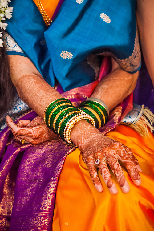 The decorated hands and arms of a bride at a wedding ceremony in Pune, India.