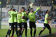 Posh players celebrate Peterborough United forward Ivan Toney (17) goal during the EFL Sky Bet League 1 match between Coventry City and Peterborough United at the Ricoh Arena, Coventry, England on 23 November 2018.