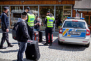 The Czech border police is checking three woman and is not allowing them to cross  the closed state border in between Germany and Czech Republic in Bayerisch Einsenstein after the corona virus outbreak changed our public lifes. Czech Republic is in the state of emergency and just their own citizens or foreigners with a residence permit are allowed to enter.