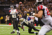 NEW ORLEANS, LA - DECEMBER 26:   Matt Ryan #2 of the Atlanta Falcons throws a pass under pressure from Roman Harper #41 and Jo-Lonn Dunbar #56 of the New Orleans Saints at Mercedes-Benz Superdome on December 26, 2011 in New Orleans, Louisiana.  The Saints defeated the Falcons 45-16.  (Photo by Wesley Hitt/Getty Images) *** Local Caption *** Matt Ryan; Roman Harper; Jo-Lonn Dunbar