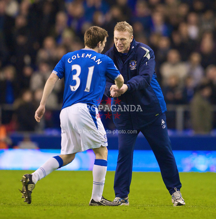 LIVERPOOL, ENGLAND - Saturday, January 16, 2010: Everton's manager David Moyes congratulates Seamus Coleman after his side's 2-0 victory over Manchester City during the Premiership match at the Goodison Park. (Photo by David Rawcliffe/Propaganda)