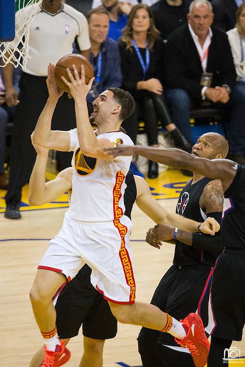 Golden State Warriors guard Klay Thompson (11) attacks the basket against the LA Clippers at Oracle Arena in Oakland, Calif., on January 28, 2017. (Stan Olszewski/Special to S.F. Examiner)