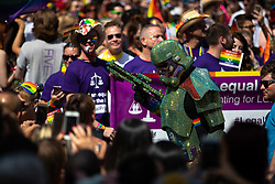 © Licensed to London News Pictures . 05/08/2018. Leeds, UK. A rainbow and glitter infused Stormtrooper . Leeds Gay Pride parade through the Yorkshire city's centre . Leeds's annual Gay Pride festiva celebrates the city's LGBTQ+ life and culture . Photo credit: Joel Goodman/LNP