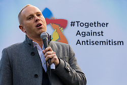 © Licensed to London News Pictures. 08/12/2019. London, UK. Judge Robert Rinder speaking  to Jewish and non-Jewish supporters from the campaign groups 'Campaign Against Antisemitism' and 'Together Against Antisemitism' at a solidarity rally against antisemitism in public life and hate crime, held at Parliament Square in Westminster.  Photo credit: Vickie Flores/LNP