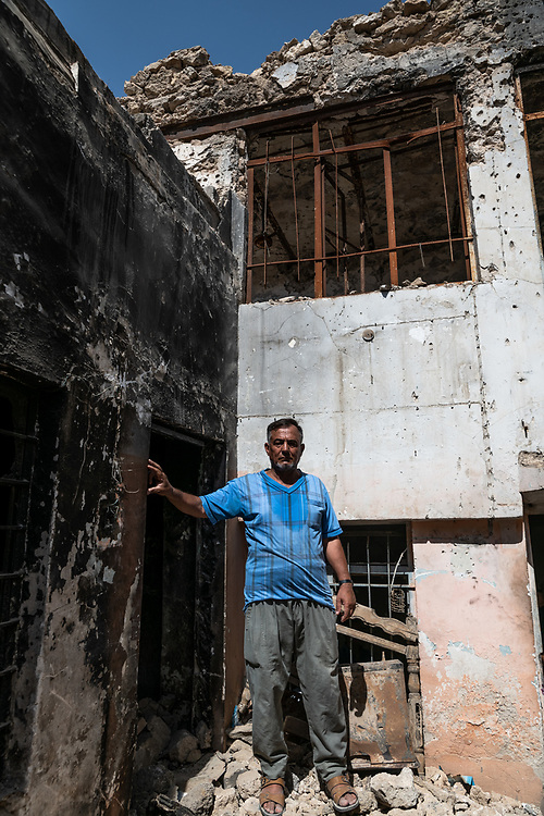 9 August 2018 – Mosul – Iraq – Father of four Youssef Shwbail, 59, stands inside his damaged home in the Myasa neighbourhood of Mosul's Old City. Shwbail's home is one of the houses that will be rehabilitated with the support of UNDP's Funding Facility for Stabilization (FFS). <br /> <br /> © UNDP Iraq / Claire Thomas