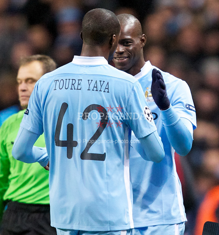 MANCHESTER, ENGLAND - Wednesday, December 7, 2011: Manchester City's Mario Balotelli comes on as a substitute for Yaya Toure during the UEFA Champions League Group A match against FC Bayern Munchen at the City of Manchester Stadium. (Pic by Vegard Grott/Propaganda)