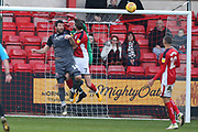 7 Chris Porter for Crewe Alexander and #1 Josh Vickers and 16 Michael Bostwick for Lincoln City all jump for the cross during the EFL Sky Bet League 2 match between Crewe Alexandra and Lincoln City at Alexandra Stadium, Crewe, England on 26 December 2018.