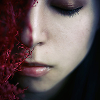 portrait of a young girl with half face covered in gloomy atmosphere
