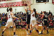 Essex's Lizzie Goodrich (20) takes a shot over CVU's Annabella Pugliese (4) during the girls basketball game between the Essex Hornets and the Champlain Valley Union Redhawks at CVU high school on Tuesday night January 26, 2016 in Hinesburg. (BRIAN JENKINS/for the FREE PRESS)
