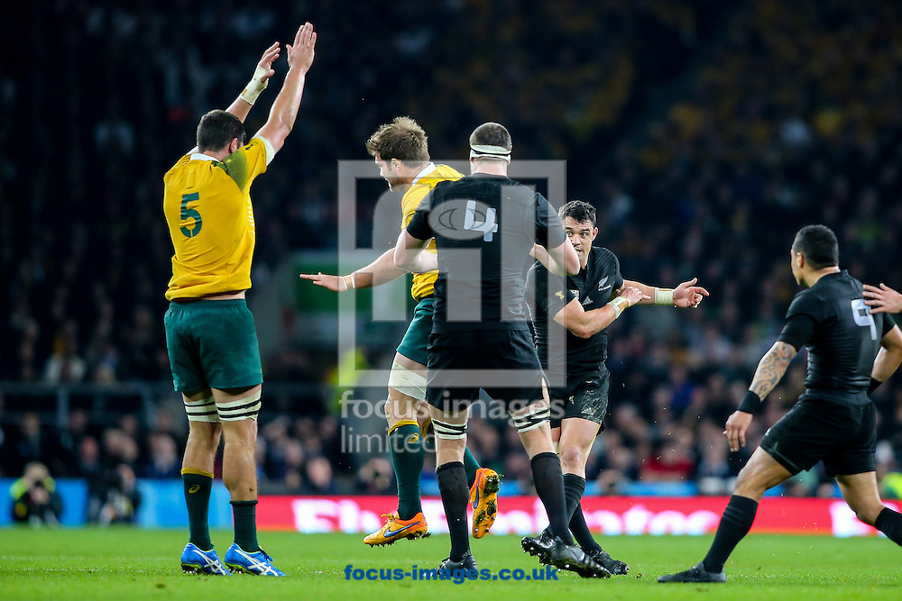Rob Simmons of Australia (left)  tries to charge down a drop goal by Dan Carter of New Zealand (second right) during the final of the 2015 Rugby World Cup at Twickenham Stadium, Twickenham<br /> Picture by Andy Kearns/Focus Images Ltd 0781 864 4264<br /> 31/10/2015