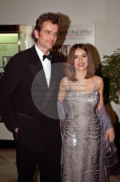 Actress Salma Hayek with friend Edward Atterton arrive for the State Dinner for Argentine President Carlos Menem January 11, 1999 at the White House.